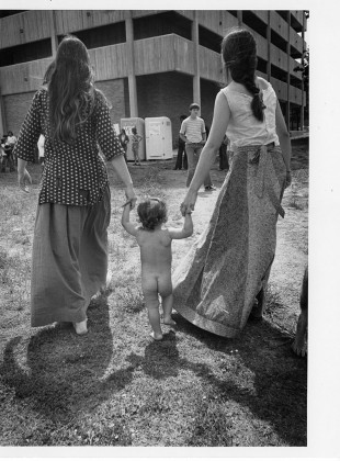 Two-women-and-nude-child-near-Stabler-Hall-Rock-festival-at-University-of-Arkansas-at-Little-Rock-1974-May-5