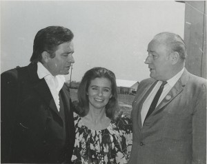 Johnny Cash and June Cash pose with Governor Winthrop Rockefeller